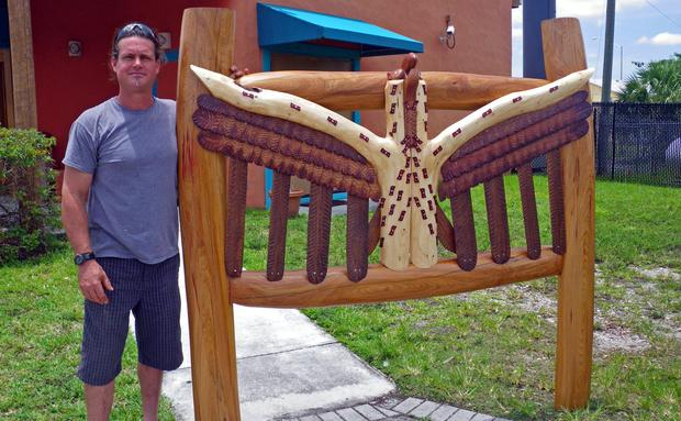 Carpenter Glennon Doyle with his custom-made headboard
