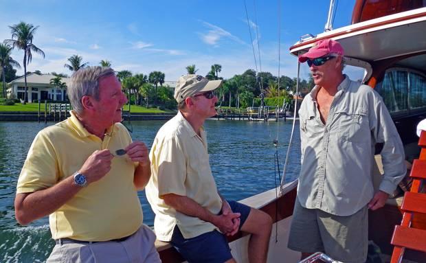 "Bob, Mike, and Kim aboard ""Legend"""